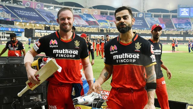 RCB Captian Virat Kohli and Ab De Villers are all smiles after seeing RCB through to a victory over Mumbai Indians in a Super Over finish. SportzPics