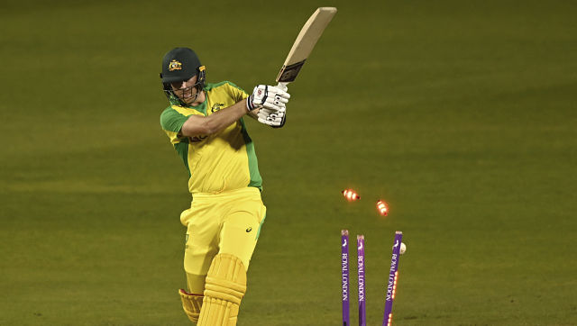 Australia's Pat Cummins is bowled out by England's Sam Curran during the second ODI cricket match between England and Australia, at Old Trafford in Manchester, England, Sunday, Sept. 13, 2020. (Shaun Botterill/Pool via AP)