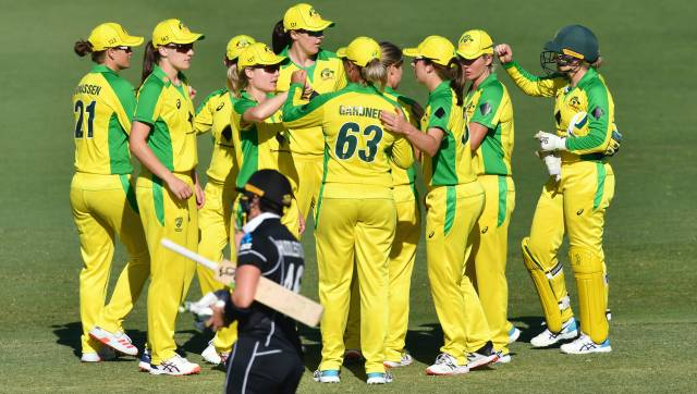 Australia teammates celebrate after winning their One Day International cricket match against New Zealand Women in Brisbane, Wednesday, Oct. 7, 2020. The Australian women's team beat New Zealand by 232 runs Wednesday to record its 21st consecutive win in one-day international cricket and equal a world mark set by Ricky Ponting's Australian men's team in 2003. (Darren England/AAP Image via AP)