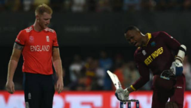 Ben Stokes looks on as Marlon Samuels celebrates West Indies' win in the ICC World T20 final. AFP