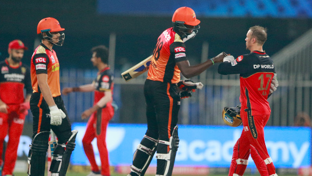 Jason Holder and AB de Villiers bump fists after SRH's five-wicket victory over RCB at Sharjah on Saturday. Sportzpics