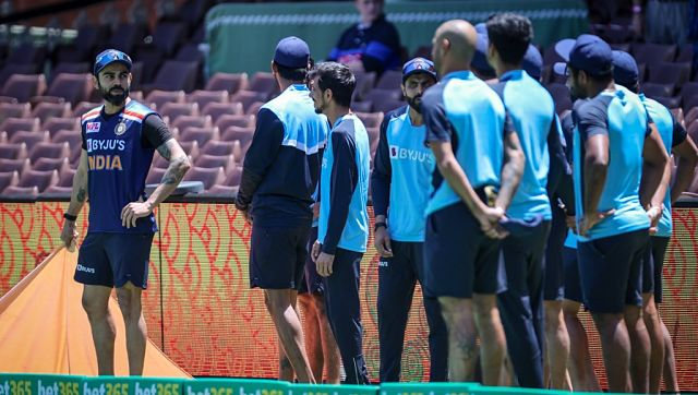 India's captain Virat Kohli (L) stands with his team before an official ceremony for the start of their one-day international cricket match against Australia at the Sydney Cricket Ground (SCG) on November 27, 2020. (Photo by DAVID GRAY / AFP) / --IMAGE RESTRICTED TO EDITORIAL USE - NO COMMERCIAL USE--