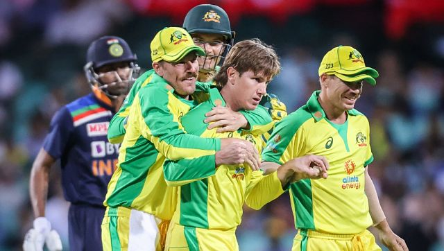 Australia's Adam Zampa (C) celebrates with teammates after dismissing India's Shikhar Dhawan during the one-day international cricket match at the Sydney Cricket Ground (SCG) in Sydney on November 27, 2020. (Photo by DAVID GRAY / AFP) / IMAGE RESTRICTED TO EDITORIAL USE - STRICTLY NO COMMERCIAL USE