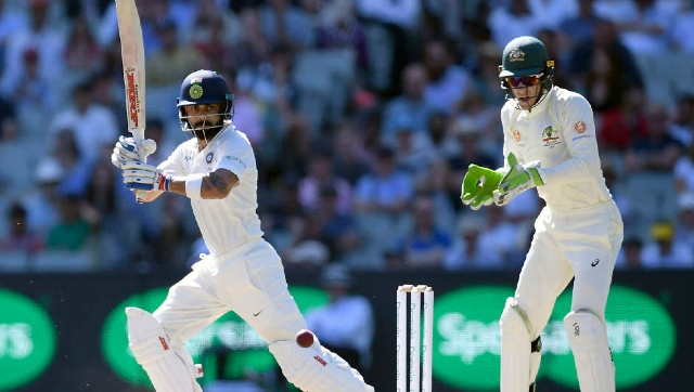 Australia's Test skipper Tim Paine (right) and his Indian counterpart Virat Kohli in action during the third Test in Melbourne on 26 December 2018. AP