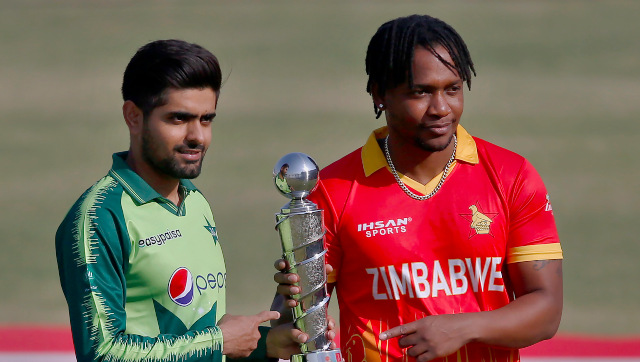Zimbabwe's skipper Chamu Chibhabha, right, his Pakistani counterpart Babar Azam, left, pose with trophy of Twenty20 series. AP