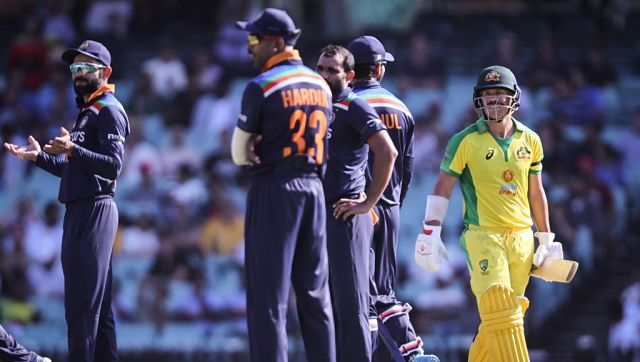 Australia's David Warner (R) reacts with India's captain Virat Kohli (L) after being dismissed during their one-day international cricket match at the Sydney Cricket Ground (SCG) in Sydney on November 27, 2020. (Photo by DAVID GRAY / AFP) / IMAGE RESTRICTED TO EDITORIAL USE - STRICTLY NO COMMERCIAL USE