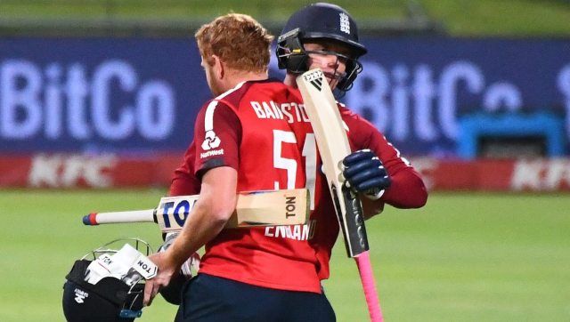 Sam Curran (R) and Jonny Bairstow (L) celebrate after England's victory over South Africa during the first T20 international. AFP