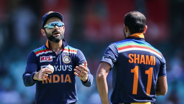 India's captain Virat Kohli (L) talks with teammate Mohammed Shami during the one-day international cricket match between India and Australia at the Sydney Cricket Ground (SCG) on November 27, 2020. (Photo by DAVID GRAY / AFP) / --IMAGE RESTRICTED TO EDITORIAL USE - NO COMMERCIAL USE--