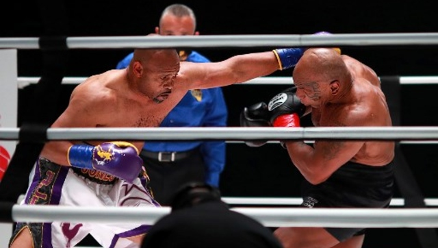 Mike Tyson returns to ring shows glimpses of destructive best in drawn exhibition bout against Roy Jones Jr