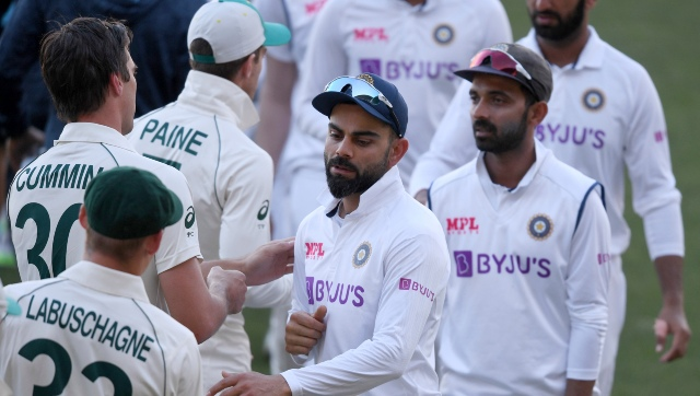 India skipper Virat Kohli, center, shakes hands with Australian players after suffering an eight-wicket defeat in the Adelaide pink ball Test. AP