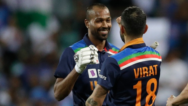 India's captain Virat Kohli, right, congratulates teammate Hardik Pandya after their win over Australia in the second T20I. AP