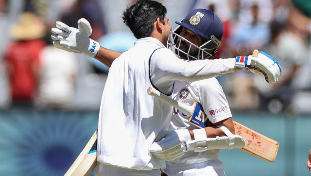 India's stand-in captain Ajinkya Rahane, right, and Shubman Gill celebrate after winning the Boxing Day Test match. AP