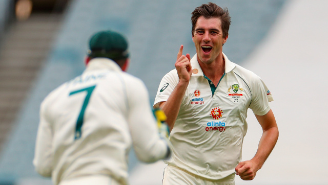 Patrick Cummins celebrates the wicket of Cheteshwar Pujara on Day 4 of the second Test at Melbourne. AP