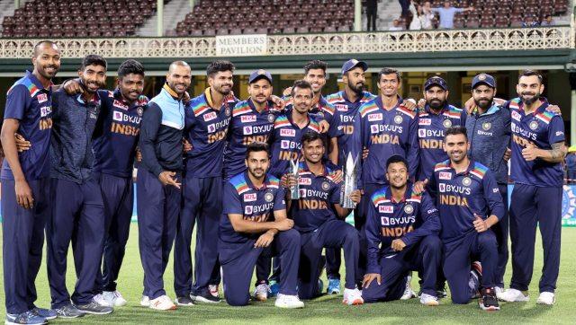 Indian players pose with the T20 cricket series trophy after the third match against Australia. AFP