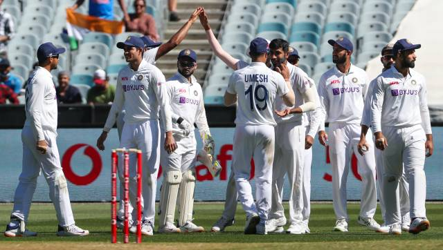 Indian players celebrate the wicket of Australia's Mitchell Starc during play on day one of the Boxing Day cricket test between India and Australia at the Melbourne Cricket Ground, Melbourne, Australia, Saturday, Dec. 26, 2020. (AP Photo/Asanka Brendon Ratnayake)