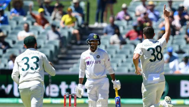 Australia's Josh Hazlewood, right, celebrates taking the wicket of India's Mayank Agarwal, center, on the third day of their cricket test match at the Adelaide Oval in Adelaide, Australia, Saturday, Dec. 19, 2020. (AP Photo/David Mairuz)