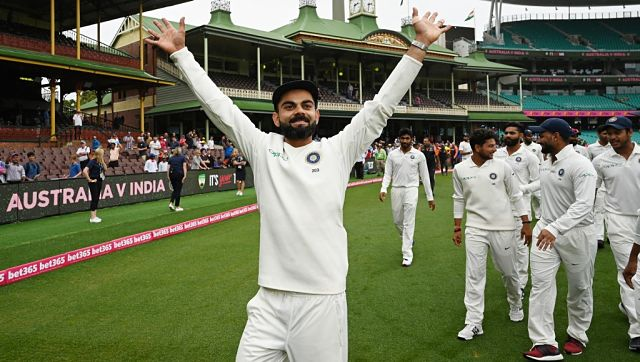 India's captain Virat Kohli (L) gestures as India team celebrates their series win on the fifth day of the fourth and final cricket Test against Australia at the Sydney Cricket Ground in Sydney on January 7, 2019. AFP