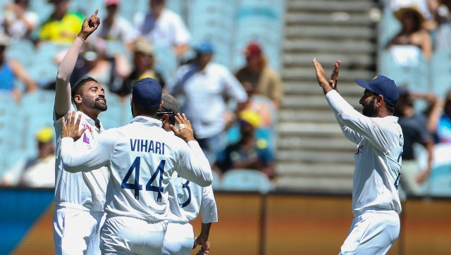 Mohammed Siraj celebrates after taking his first Test wicket for India. AP