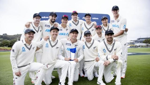 The triumphant New Zealand players pose with the Test series trophy. AFP