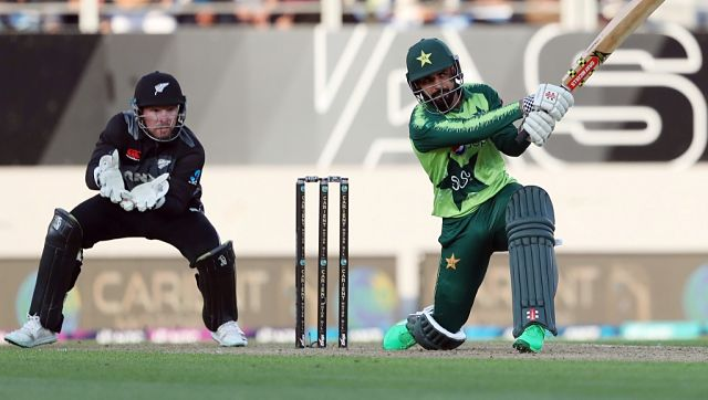 Pakistan's captain Shadab Khan bats as New Zealand's wicketkeeper Tim Seifert (L) looks on during the first T20I. AFP