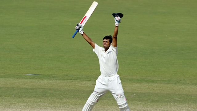 Rahul Dravid celebrates after hitting the winning runs against Australia on the final day of the second Test Match being played in Adelaide, 16 December 2003. AFP