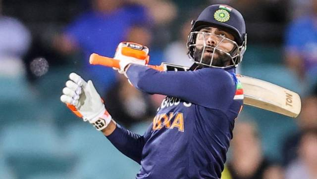 India's Ravindra Jadeja hits a boundary during the T20 cricket match between India and Australia at Manuka Oval in Canberra on December 4, 2020. (Photo by DAVID GRAY / AFP) / -- IMAGE RESTRICTED TO EDITORIAL USE - STRICTLY NO COMMERCIAL USE --