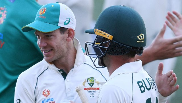 Australian skipper Tim Paine (L) celebrates with Joe Burns after hosts' eight wickets win over India at Adelaide. AP