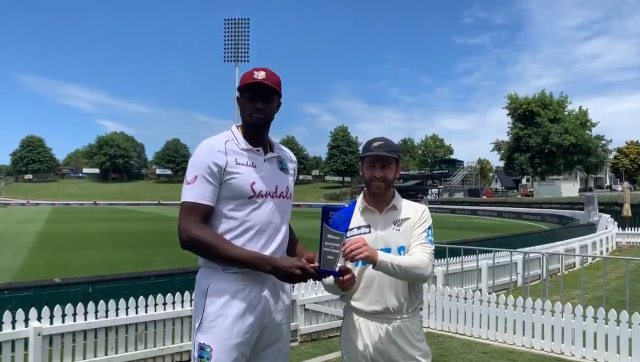 West Indies captain Jason Holder and New Zealand skipper Kane Williamson with the Test series trophy. Image: Screen grab from @windiescricket's video