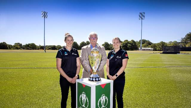 Sir Richard Hadlee poses with the Women's World Cup trophy in Christchurch. ICC Media