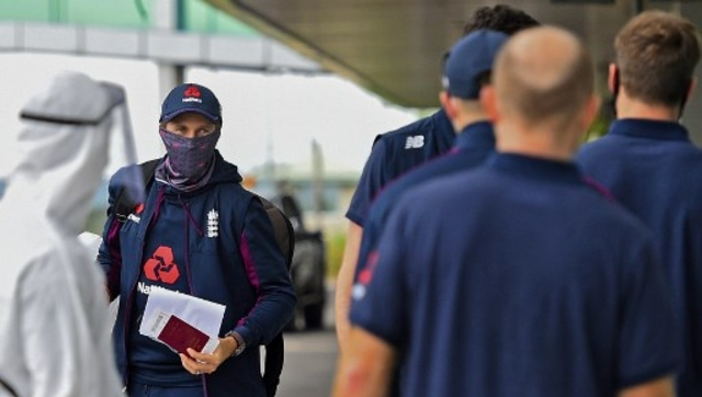 England's captain Joe Root along with teammates arrive at the Rajapaksa International Airport in Mattala. AFP