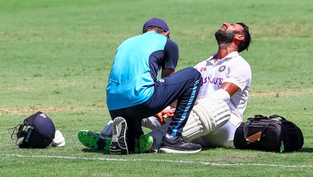 Cheteshwar Pujara battled his way through pain after copping multiple blows to produce a gritty 54 on the final day. Image: AP