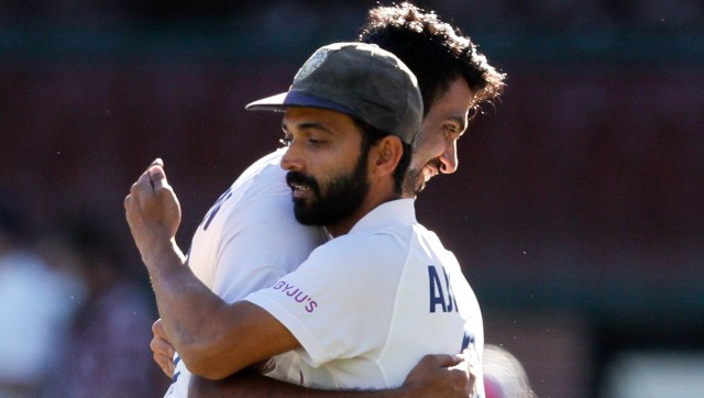 Ajinkya Rahane congratulates R Ashwin after India secure a draw against Australia at Sydney. AP