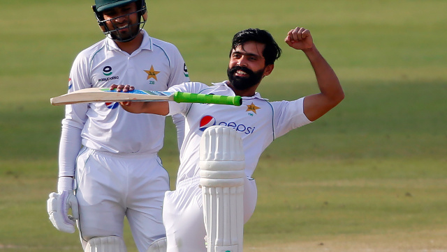 Fawad Alam celebrates after reaching his third Test century on Day 2 of the first Test against South Africa at Karachi. AP