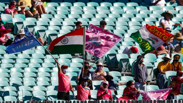 Indian fans wave flags at the Sydney Cricket Ground during the third Test against Australia. AP
