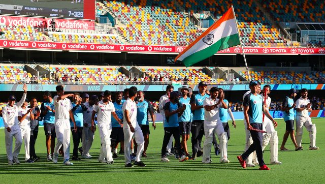 Indian players celebrate after defeating Australia by three wickets on the final day of the fourth cricket Test at the Gabba, Brisbane, Australia. AP