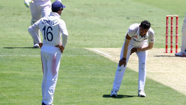 Despite teh risk of aggravating his injury, Navdeep Saini bowled five overs in the second innings of the Brisbane Test. AP
