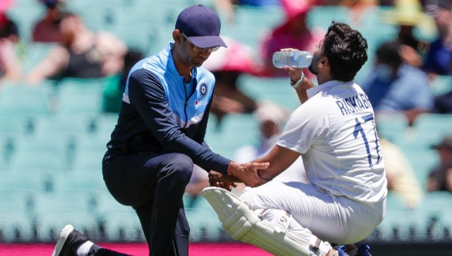 Rishabh Pant injured his left elbow trying to pull a short ball from Pat Cummins. AP