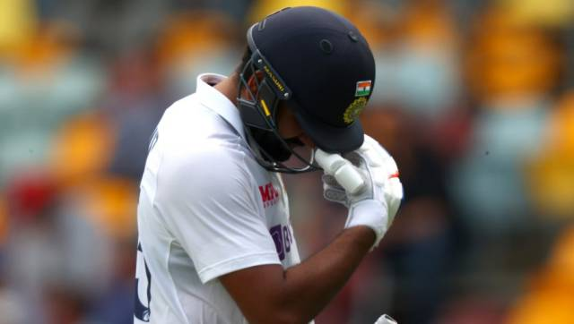 Indian batsman Rohit Sharma departs after his dimissal on day two of the fourth cricket Test match between Australia and India at the Gabba in Brisbane on January 16, 2021. (Photo by Patrick HAMILTON / AFP) / --IMAGE RESTRICTED TO EDITORIAL USE - STRICTLY NO COMMERCIAL USE--
