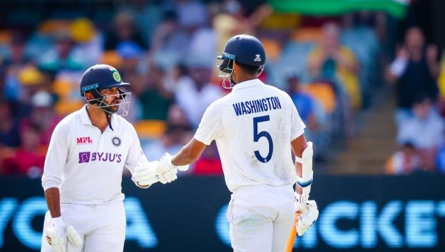 India's Washington Sundar (R) is congratulated by Shardul Thakur (L) after reaching his half century during day three of the fourth cricket Test match between Australia and India at the Gabba in Brisbane on January 17, 2021. (Photo by Patrick HAMILTON / AFP) / -- IMAGE RESTRICTED TO EDITORIAL USE - STRICTLY NO COMMERCIAL USE --