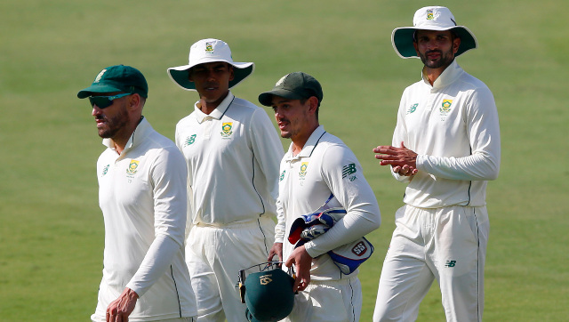 Skipper Quinton de Kock leaves the field with South Africa teammates after the first Test ended with them suffering a seven-wicket defeat on Day 4. AP