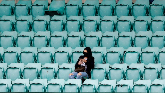 A socially distant fan watch the third Test between India and Australia at the Sydney Cricket Ground. AP