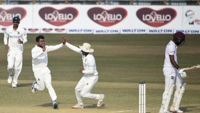 Mehidy Hasan (2L) needs only three more wickets to become just the fourth all-rounder to get a hundred with the bat and take 10 wickets in the same Test. AFP