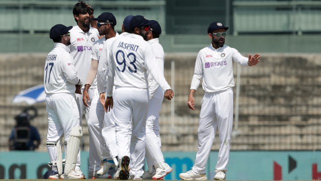 Teammates congratulate Ishant Sharma after he dismisses Dan Lawrence to reach the 300-Test wicket landmark. Image: Sportzpics for BCCI