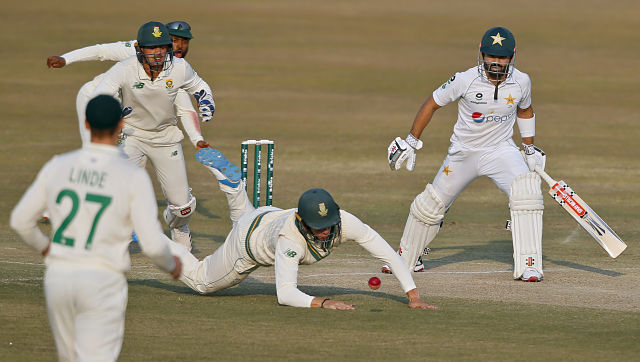 Pakistan's Mohammad Rizwan (right) looks as South Africa's Rassie van der Dussen, center, drops his catch during the third day of the second Test in Rawalpindi. AP Photo