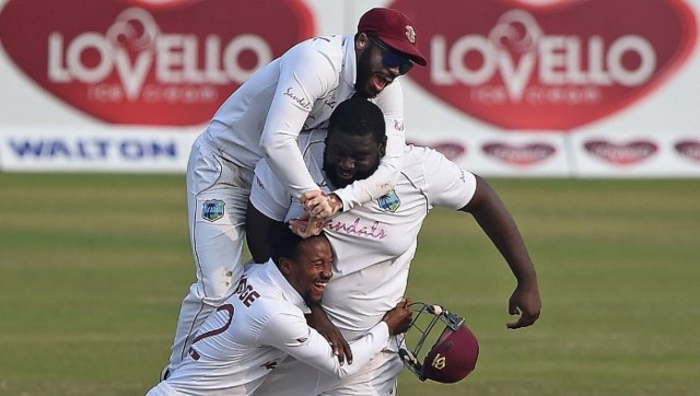 Rahkeem Cornwall celebrates with teammates after picking up a wicket in West Indies' win over Bangladesh. AFP