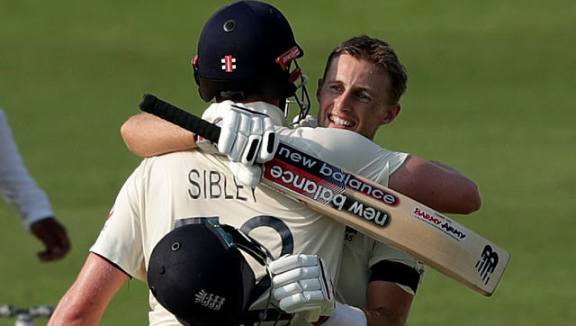 England's Joe Root and Dom Sibley embrace during Day 1 of the 1st Test against India in Chennai. Image courtesy: Twitter / @englandcricket