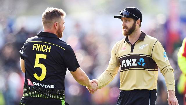 Australia skipper Aaron Finch and his New Zealand counterpart Kane Williamson greet each other. AP