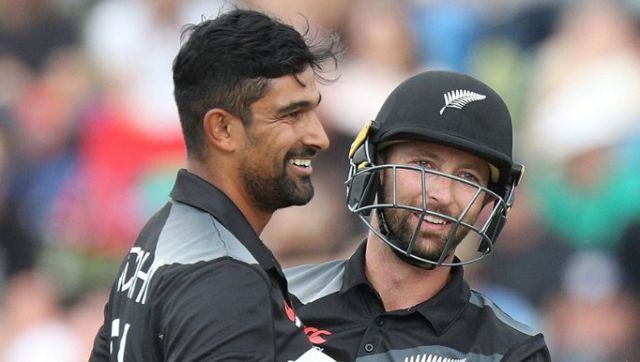 New Zealand's Ish Sodhi (L) is congratulated by wicketkeeper Devon Conway after taking the wicket of Bangladesh's Soumya Sarkar during the first Twenty20 cricket match between New Zealand and Bangladesh at Seddon Park in Hamilton on March 28, 2021. (Photo by DAVID ROWLAND / AFP)