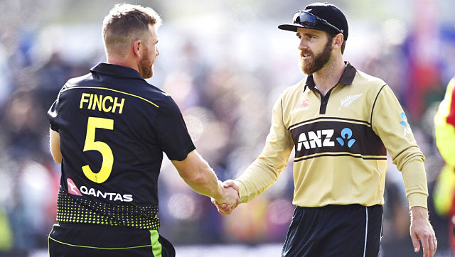 Australian captain Aaron Finch, left, with New Zealand captain Kane Williamson. (Andrew Cornaga/Photosport via AP)
