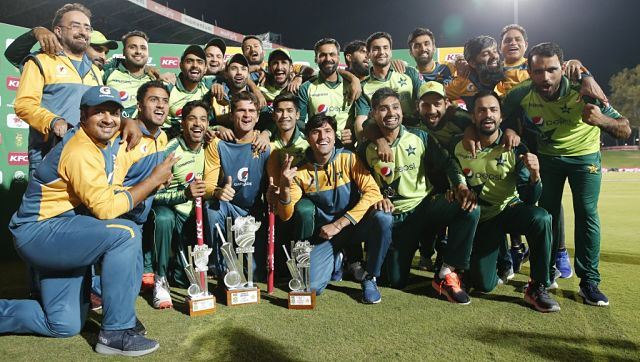 Pakistan players and support staff celebrate their series victory after the fourth T20I. AFP